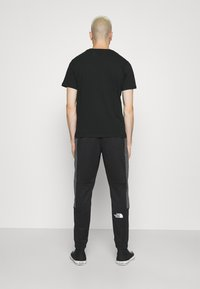 The North Face - CUFFED PANT - Träningsbyxor - black - 2