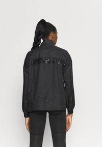 Puma - TRAIN JACKET - Training jacket - black - 2