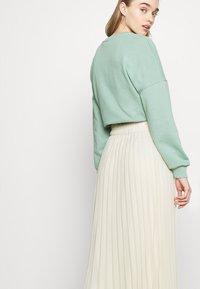 Monki - LAURA PLISSÉ SKIRT - A-line skirt - beige - 4