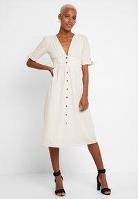 Vero Moda - VMMILA CALF DRESS - Shirt dress - snow white/oatmeal - 0