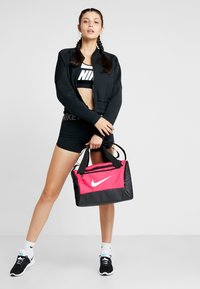 Nike Performance - Bolsa de deporte - rush pink/black/white - 1