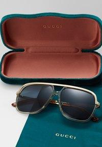 Gucci - Solbriller - brown/gold-coloured/blue - 2
