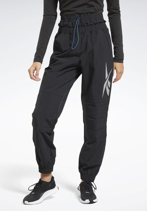 MYT PANTS - Tracksuit bottoms - black