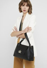 Calvin Klein - LOCK TOP HANDLE SATCHEL - Handbag - black - 1