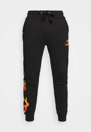 FLAME JOGGER - Tracksuit bottoms - black