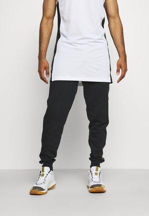 CURRY JOGGER - Pantalones deportivos - black/white