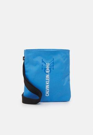 MICRO FLATPACK OUTLINE UNISEX - Across body bag - blue