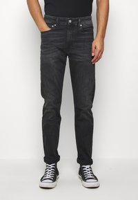 Calvin Klein Jeans - SLIM TAPER - Slim fit jeans - washed black - 0