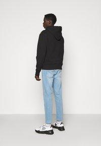 Versace Jeans Couture - PRINT LOGO BAROQUE - Zip-up sweatshirt - black - 2