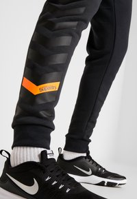 Superdry - COMBAT BOXER JOGGER - Tracksuit bottoms - black - 4