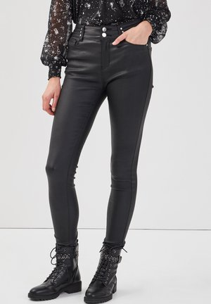 MIT NIETEN - Trousers - denim noir enduit