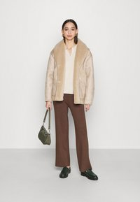 NA-KD - STEPHANIE DURANT SLANTED POCKET - Light jacket - beige - 1