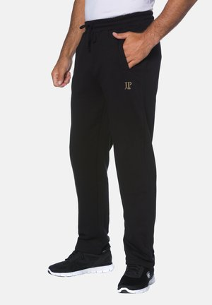 MIT ELAST - Tracksuit bottoms - black