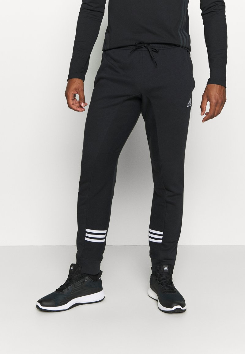 adidas Performance - ESSENTIALS TRAINING SPORTS PANTS - Tracksuit bottoms - black/white
