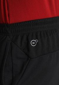 Puma - LIGA TRAINING PANTS - 3/4 sports trousers - black/white - 5