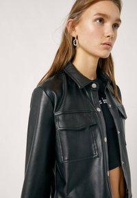 PULL&BEAR - Faux leather jacket - mottled black - 3