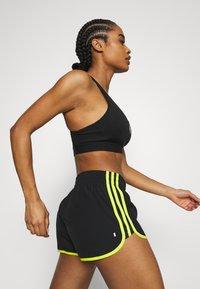 adidas Performance - M20 SHORT - Sports shorts - black/acid yellow - 3