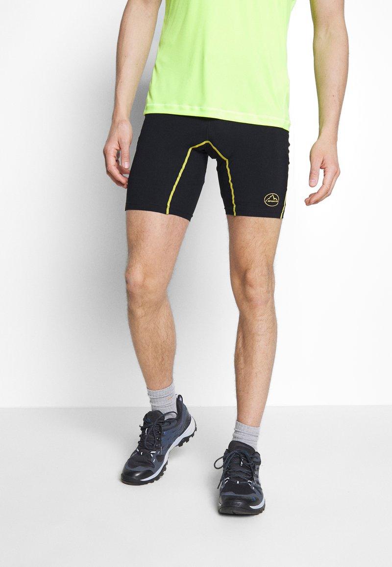 La Sportiva - FREEDOM TIGHT SHORT - Leggings - black/yellow