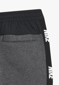 Nike Sportswear - HYBRID PANT - Trainingsbroek - obsidian mist/football grey/track red - 3