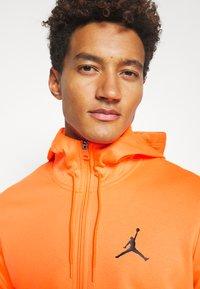 Jordan - AIR THERMA FULL ZIP - Fleece jacket - total orange/black - 5