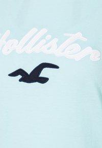 Hollister Co. - TIMELESS - Print T-shirt - light blue - 4