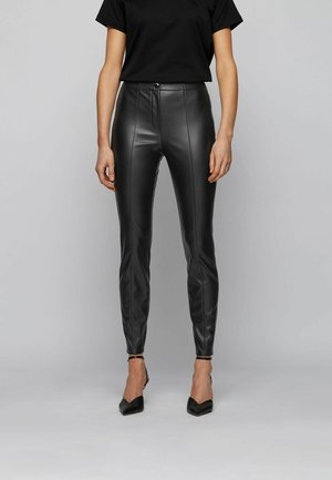 C_TRATONA - Trousers - black