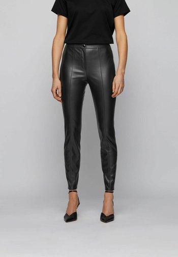C_TRATONA - Trousers - black