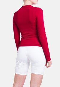 SPORTKIND - Sports shirt - bordeaux rot - 1