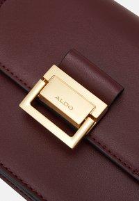 ALDO - PENTZIA - Across body bag - bordo/gold-coloured - 3