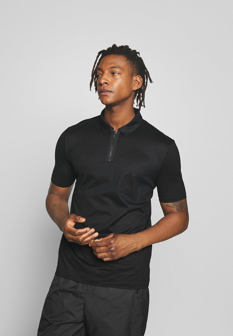 HUGO - DOLDEN - Polo shirt - black