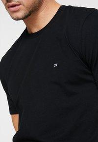 Calvin Klein - Jednoduché triko - black - 4