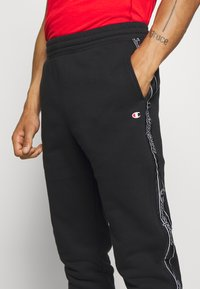 Champion - LEGACY  - Pantalon de survêtement - black - 5