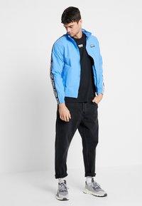 adidas Originals - REVEAL YOUR VOICE TEE - Basic T-shirt - black - 1