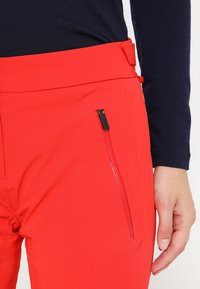 Kjus - WOMEN FORMULA PANTS - Snow pants - fiery red - 3