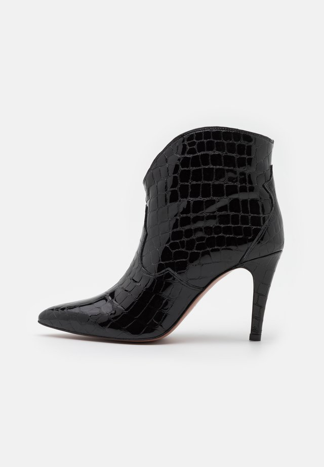 High heeled ankle boots - algarve