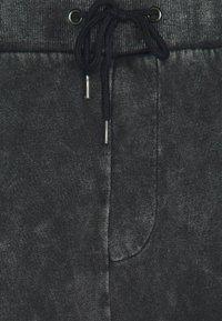 YOURTURN - Loose Fit UNISEX - Tracksuit bottoms - mottled dark grey - 2