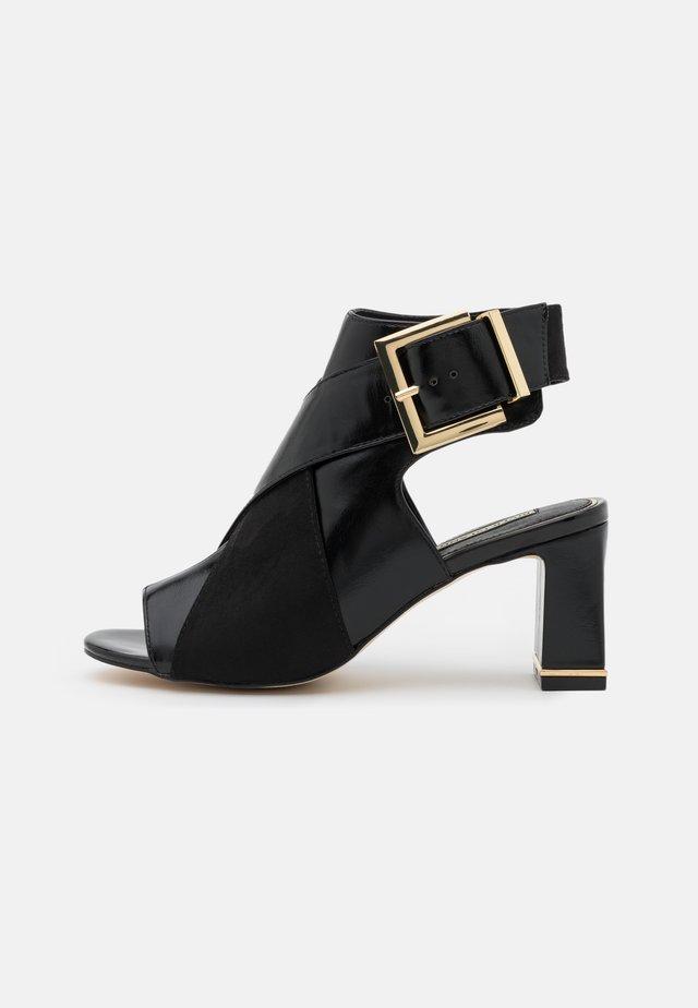 Sandalias tobilleras - black