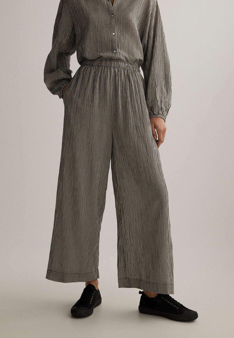 OYSHO - Trousers - black