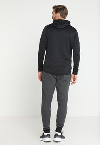 Under Armour - UNSTOPPABLE JOGGER - Tracksuit bottoms - black/black - 2