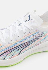 Puma - ELECTRIFY NITRO SP  - Neutral running shoes - white - 5