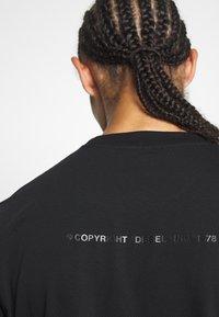 Diesel - T-JUST-SLITS-X83 T-SHIRT - Print T-shirt - black - 4