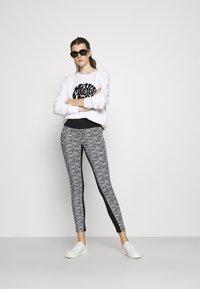 MICHAEL Michael Kors - LOGO LUX - Leggings - Trousers - white/black - 1