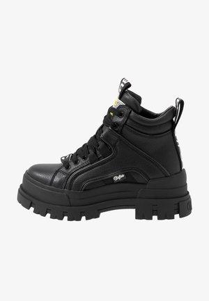 VEGAN ASPHA MID - Platform ankle boots - black