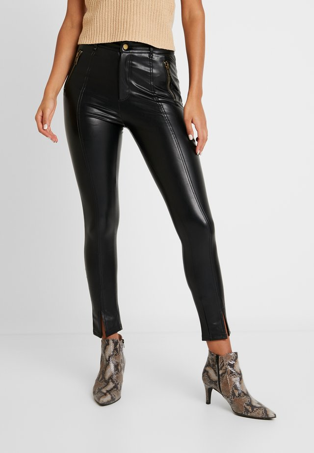 PANT WITH ZIPPER POCKET AND SLIT FRONT DETAIL - Trousers - black