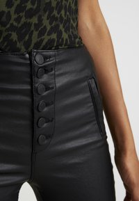 ONLY - ONLROYAL COATED BUTTON PANT - Spodnie materiałowe - black - 5