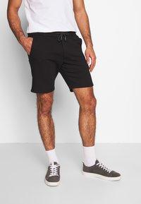 Pier One - Pantalon de survêtement - black - 0