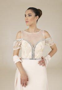 Fabiana Ferri - ALMA - Galajurk - gold - 3
