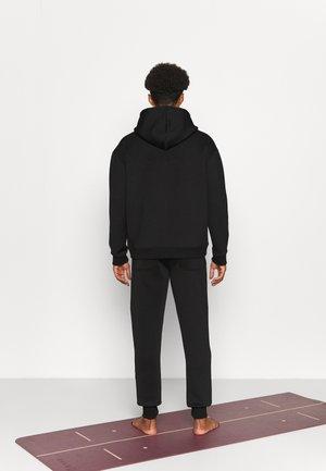 LONG PANTS DIVIDING SEAMS - Teplákové kalhoty - black