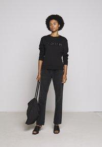 HUGO - NICCI - Long sleeved top - black/silver - 1