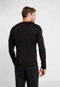 Your Turn Active - Maglietta a manica lunga - black - 2